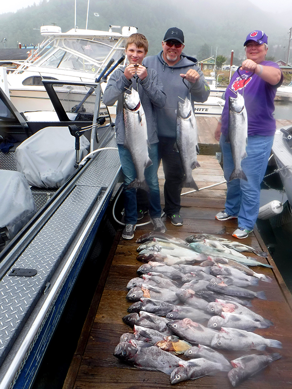 Mom, Dad, and Son with their Catch - Spring Salmon Fishing - Oregon - St. Laurent Guide Service